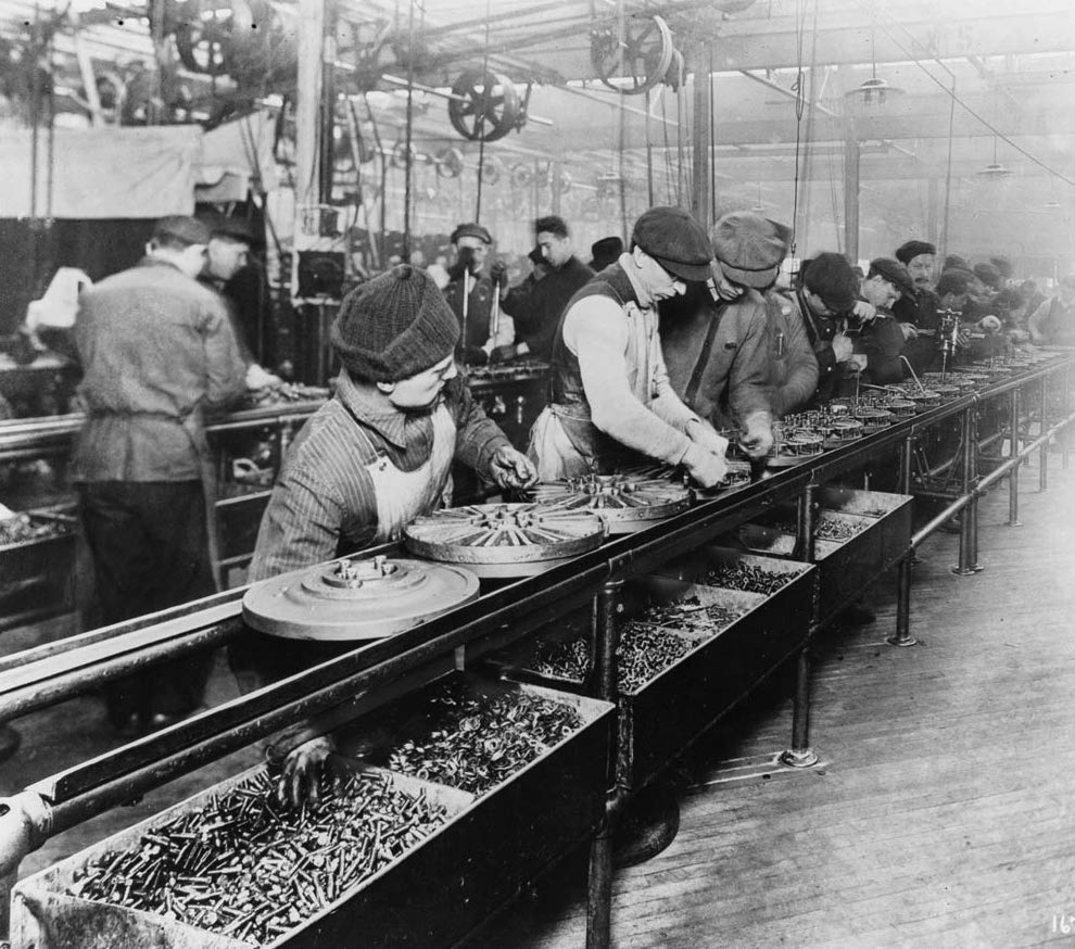 Workers on the moving assembly line