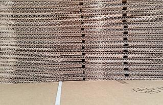 Image of stacked cardboard boxes. Consumers are growing to prefer environmentally-friendly packaging.